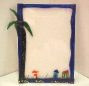 Glass frame with palm tree and houses